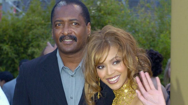 Beyoncé arrives at the 2004 Grammy Awards with her father and then-manager, Mathew Knowles, in Los Angeles.