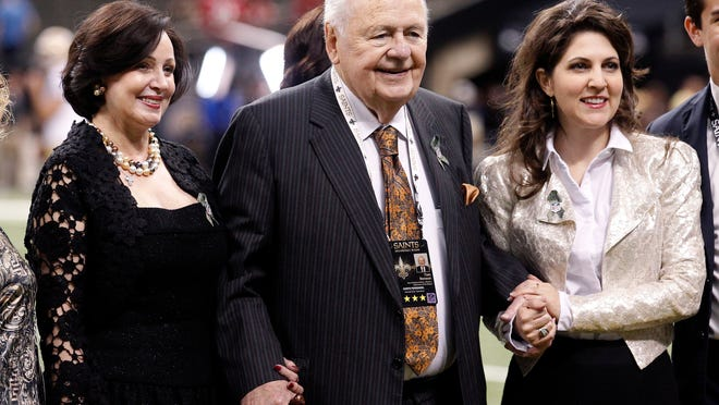New Orleans Saints owner Tom Benson poses for a photo with his wife Gayle Benson, left, and granddaughter, co-owner Rita Benson LeBlanc, before an NFL football game against the San Francisco 49ers in New Orleans in 2014.
