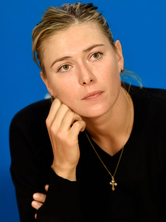 Maria Sharapova of Russia speaks during a press conference after her women's singles final loss to Serena Williams of the U.S. at the Australian Open tennis championship in Melbourne, Australia, Saturday, Jan. 31, 2015. (AP Photo/Andy Brownbill)