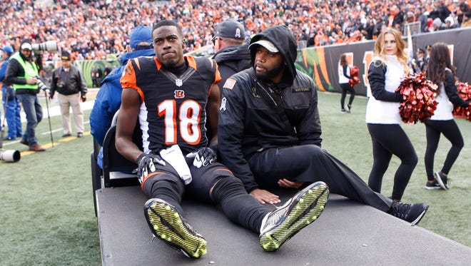 Cincinnati Bengals wide receiver Cody Core (16) is carted off the field after an apparent injury in the first half of an NFL football game against the Buffalo Bills, Sunday, Nov. 20, 2016, in Cincinnati.