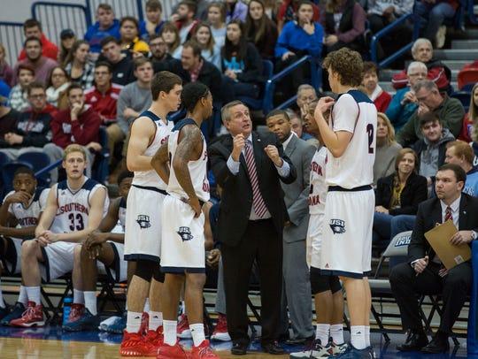 USI's Head Coach, Rodney Watson, talks to his players