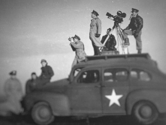 "John Ford, seen shooting World War II propaganda in a scene from the Netflix documentary series ""Five Came Back."""