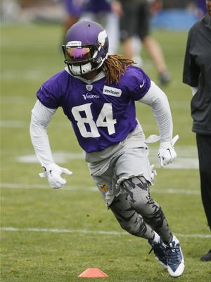 Minnesota Vikings wide receiver Cordarrelle Patterson (84) takes part in a passing drill during Tuesday's mini-camp in Eden Prairie.