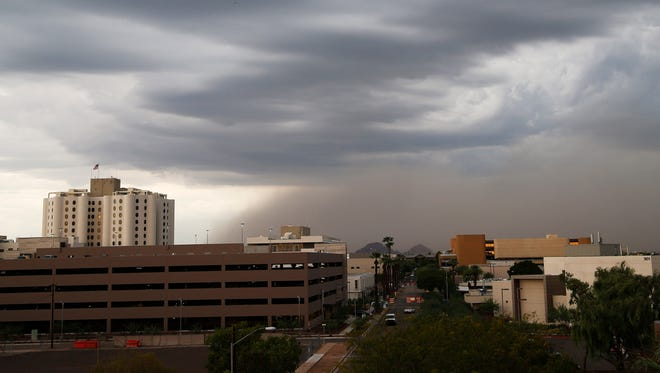 A dust storm moves over the East Valley ahead of a monsoon storm August 25, 2015.