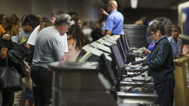 People wait in the Southwest Airlines check-in line at Sky Harbor International Airport, Thursday, July 21, 2016.