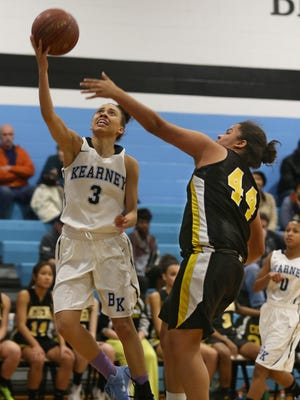 Bishop Kearney's Rosa Graham, left, drives in for two past the defense of Greece Athena's Sophia Jordan during their game at Bishop Kearney on Feb. 19, 2016.