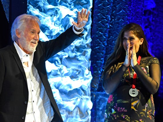 Hillary Scott, right, cheers as the SESAC Legacy Award was presented to music icon Kenny Rogers at the 2017 SESAC Music Awards Sunday Nov. 5, 2017, in Nashville, TN