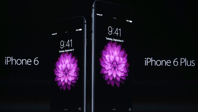 Apple CEO Tim Cook announces the iPhone 6 during an Apple special event at the Flint Center for the Performing Art.