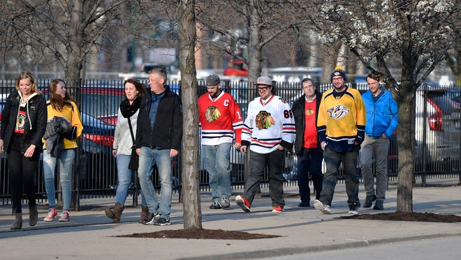 Predators and Blackhawks fans arrive before the start of the first game in the first-round NHL playoff series at the United Center, Thursday, April 13, 2017, in Chicago, Ill.