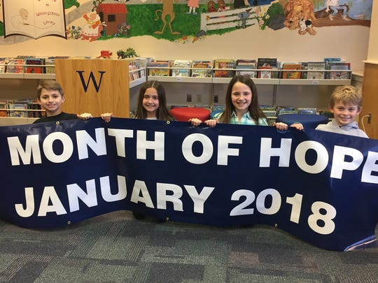 """Wilson School designated January the """"Month of Hope,"""" with students, staff and parents working together to raise donations for and awareness of a number of charities.  From left are third graders Chase Roofener, Skylar Abo, Logan Partridge, and Dylan Dwan"""