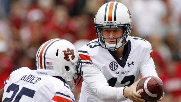 Auburn quarterback Sean White looks to hand ball off