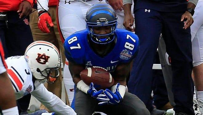 Memphis receiver Tevin Jones catches a pass Wednesday against Auburn in the Birmingham Bowl.