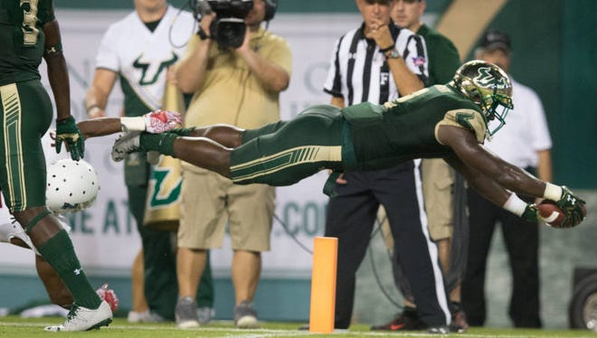 University of South Florida junior D'Ernest Johnson, an Immokalee graduate, dives for a touchdown on Saturday in a win over Northern Illinois.