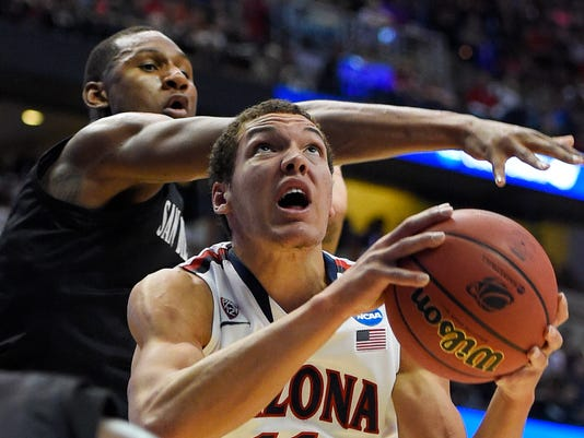 San Diego State guard Xavier Thames, left, defends as Arizona forward Aaron Gordon drives during the first half of an NCAA men's college basketball tournament regional semifinal, Thursday, March 27, 2014, in Anaheim, Calif. (AP Photo/Mark J. Terrill)