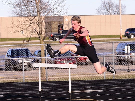 Luxemburg-Casco senior Sam Larson competes in the 300-meter hurdles during a triangular at Luxemburg on April 4. Larson broke the school record in the event this season with a time of 39.24 seconds.