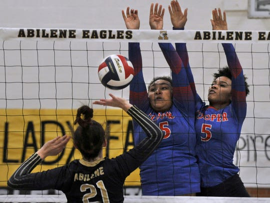 Abilene High School's Sydney Lawler tries to recover