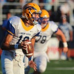 Newport Central Catholic quarterback Patrick Henschen rolls out to pass in an 8-7 loss to Scott Aug. 21.