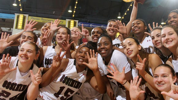 Ossining players celebrate their 7th gold ball victory after defeating Alberts Magnus 80-77 to win the Section 1 Class AA championship at the Westchester County Center in White Plains March 5, 2017.