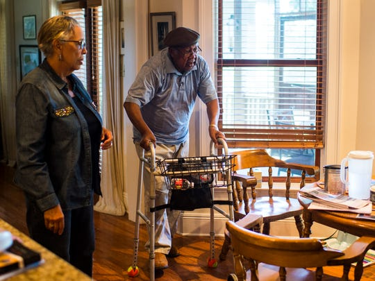 Dianne Gaines and Ernest Gaines approach their kitchen table to prepare for lunch at their home in Oscar, La., Tuesday, Sept. 23, 2014.