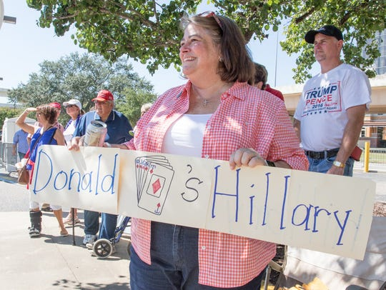 Sue Imho-Ehlers holds a sign in support for Donald