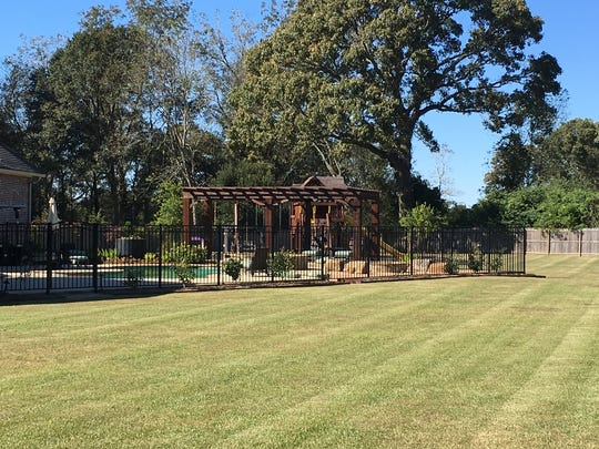 The home has a huge yard and plenty of room for a large family.