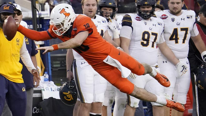Illinois quarterback Brandon Peters (18) dives for a first down during the Redbox Bowl in a Dec. 30, 2019, file photo.