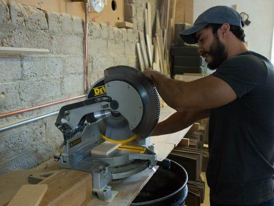 Daniel Lopez, a counter top specialist and carpenter,