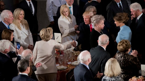President Trump shakes hands with Hillary Clinton as