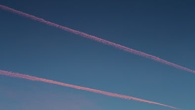 People in Asheville took to social media after spotting a plane, which appeared to be a small, vintage aircraft. The plane was releasing a trail of smoke that appeared orange in the sunset, wrote Virginia Daffron, a Mountain Xpress reporter, somewhat similar to these jet contrails photographed in California in March 2017.