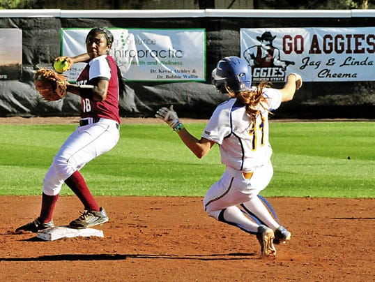 Jaime Guzman/For the Sun-News   New Mexico State second baseman Rachel Rodriguez gets ready to turn a double play during Saturday during the WAC Tournament championship game against California State-Bakersfield at the NMSU Softball Complex.