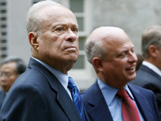 In this Sept. 22, 2009, file photo, Washington Nationals owner Ted Lerner, left, and his son Mark Lerner, right, attend a reception for Baseball Hall of Famer Tommy Lasorda at the Smithsonian's National Portrait Gallery in Washington. A New York state judge has thrown out an arbitration decision that said the Mid-Atlantic Sports Network, which is controlled by the Baltimore Orioles, owes the Washington Nationals about 298 million for the team's 2012-16 television rights. MASN and the Orioles sued in New York State Supreme Court last year, claiming the arbitration was improper because the law firm Proskauer Rose, which represented the Nationals, at times worked for MLB and the teams of all three arbitrators.
