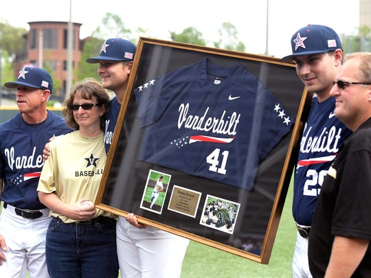 Vanderbilt baseball coach Tim Corbin, left, and players honored Donny Everett, a Vanderbilt pitcher who drowned last June, during a pre-game ceremony before a game with Florida on Saturday, April 15, 2017. Everett's mother, Susan, and father, Teddy, were presented Donny's uniform during the ceremony.