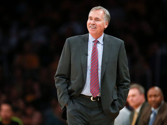 "FILE - In this March 9, 2014, file photo, then-Los Angeles Lakers coach Mike D'Antoni walks the sideline during the NBA basketball team's gane against the Oklahoma City Thunder in Los Angeles. D'Antoni is headed to Houston to try his ""Seven Seconds or Less"" offense with James Harden, one of the NBA's most explosive offensive threats. D'Antoni reached agreement with the Rockets on a four-year deal on Thursday, May 26, 2016, a person with knowledge of the situation told The Associated Press. The person spoke on condition of anonymity because the team has not announced the hiring, which was first reported by Yahoo! Sports. (AP Photo/Danny Moloshok, File)"