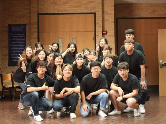 Yujung Nam, 22, president of the Korean Student Association at Angelo State University (pictured center wearing a hat), said there are about 20 members, which is a decrease from last year.