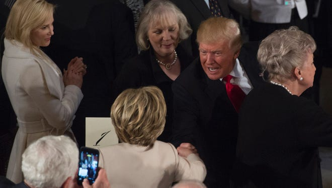 President Donald Trump greets former secretary of State Hillary Clinton in Statuary Hall at the Inaugural Luncheon following Donald Trump's inauguration on Jan. 20, 2017.
