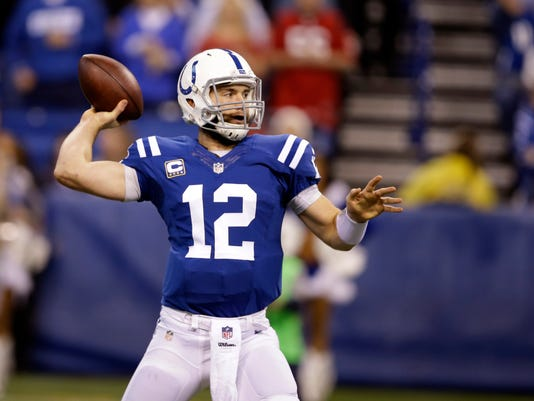 Indianapolis Colts quarterback Andrew Luck throws against the Houston Texans during the first half of an NFL football game in Indianapolis, Sunday, Dec. 14, 2014. (AP Photo/Darron Cummings)
