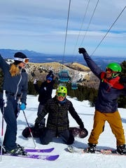 Visitors at Ski Apache enjoying all the trill that is wintry fun.