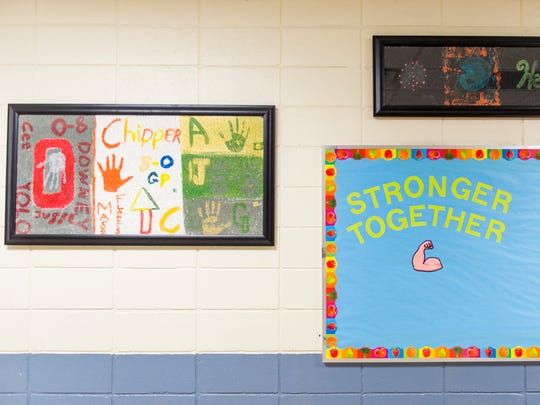 Ceiling tiles painted by former students, which were saved after being damaged by smoke in the Gatlinburg wildfires, hang in the hallways of Pi Beta Phi Elementary School on Aug. 22, 2017. Two sisters who attended the school were killed in the wildfires.