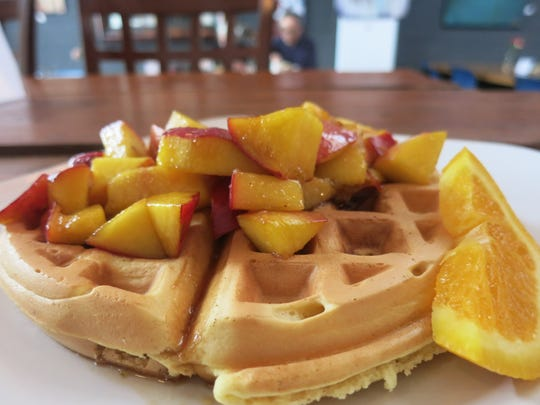 A malted waffle stuffed with bacon and topped with sauteed peaches was a recent Sunday brunch feature at Yemans Street pop-up restaurant in Hamtramck.