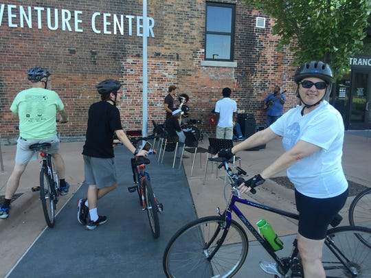 Cyclists training for the Wayne State University bike ride encountered the Jeffrey Trent Trio as they played jazz outside the Outdoor Adventure Center, near Atwater at the foot of the Dequindre Cut.