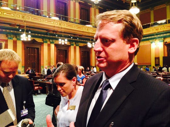 House Minority Leader Tim Greimel, D-Auburn Hills, talked with reporters after the House passed a resolution to create a committee to investigate a sex scandal and cover-up involving state Reps. Todd Courser, R-Lapeer, and Cindy Gamrat, R-Plainwell.