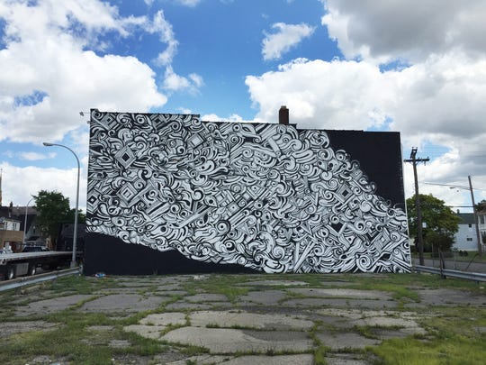 A mural by the San Francisco-based artist Victor Reyes at 2238 Holbrook in Hamtramck on August 5, 2015.
