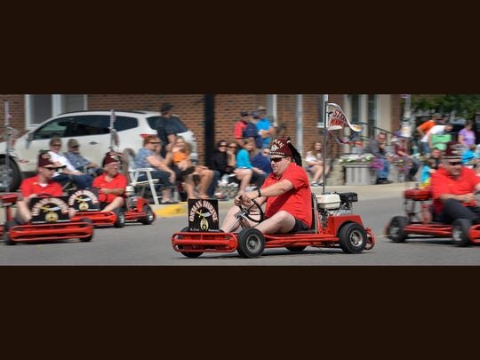 The Osman Shrine Go-Karts dart along the parade route during the 2015 Pierz Oktoberfest parade.