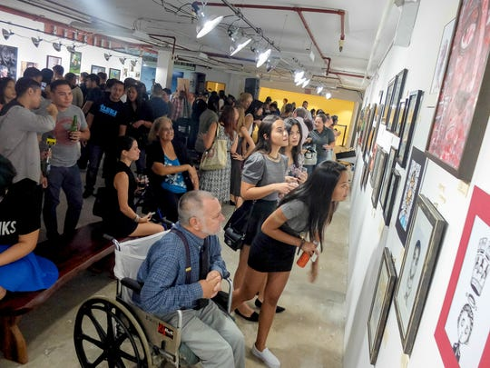 The Guam Art Exhibit at Agana Shopping Center is shown