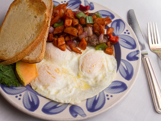 Smoked beef medallions with sweet potato hash and eggs