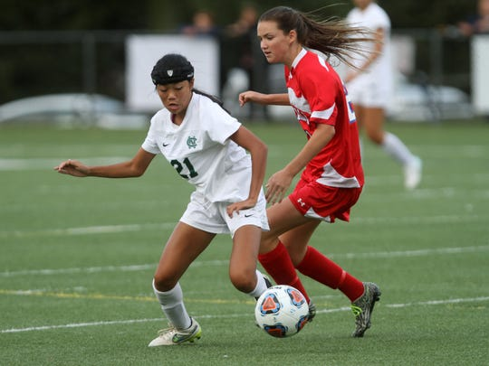Colts Neck's Kayla Lee, left, looks to control the