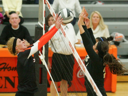 Ridgewood senior Laura Crawford works close to the net Thursday night during the Generals' 3-2 loss to Central Catholic.