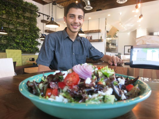 Executive chef and Dearborn native Zane Makky created the menu for Brome Burgers & Shakes, including the colorful Farmers Market salad shown in the foreground.