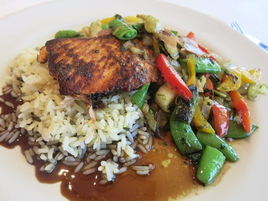 The Brighton Bar and Grill's Drunken Salmon served atop rice with sauteed vegetables and spicy shrimp sauce is a longtime favorite at the restaurant.