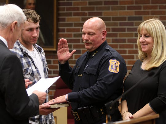 Deputy chief William Krause is flanked by his son Matt and wife Kathy as he is sworn in as East Brunswick police chief, Thursday, October 22, 2015, by Mayor David Stahl in East Brunswick.